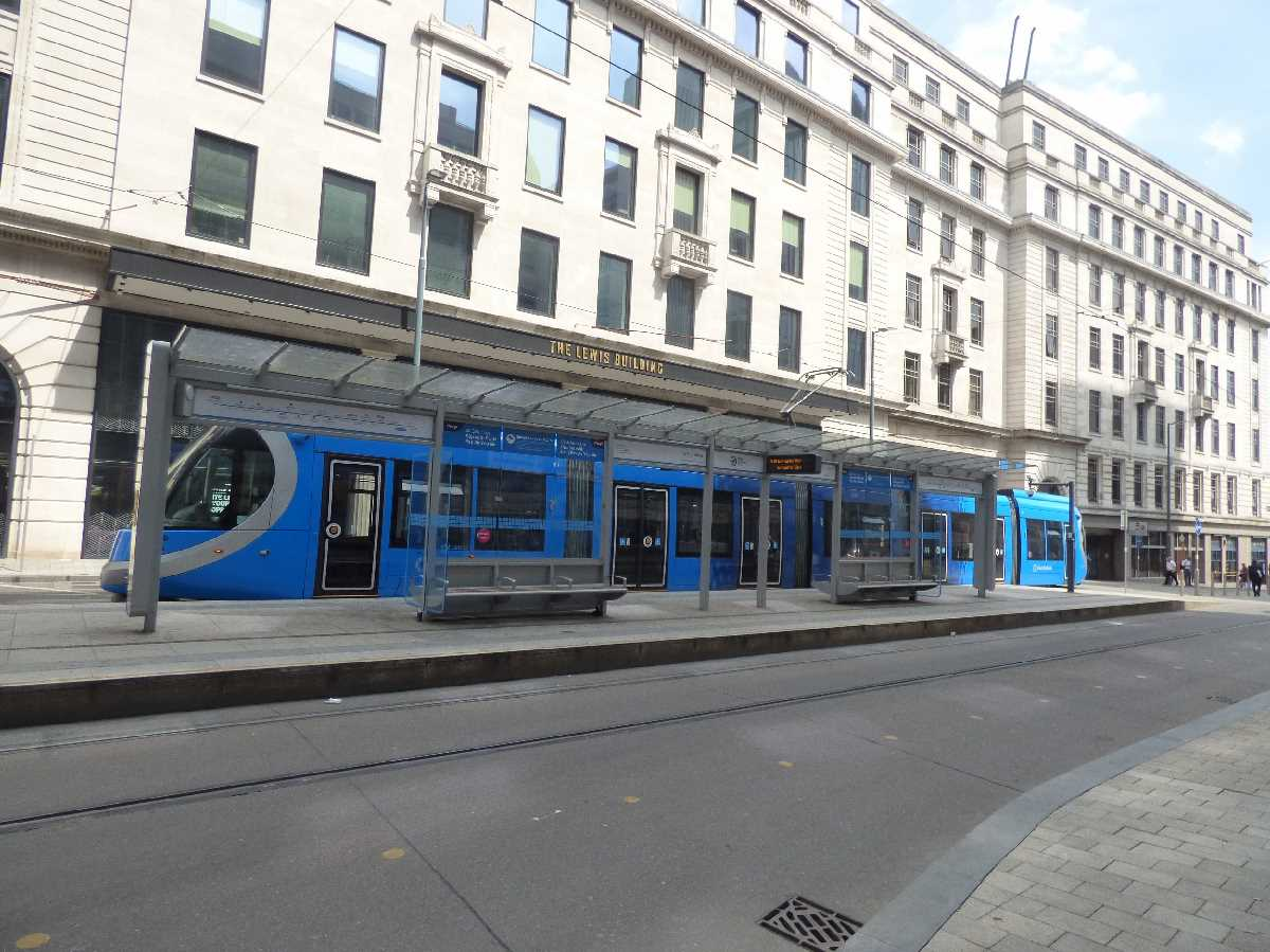Blue tram 31 standing at Bull Street outside The Lewis Building